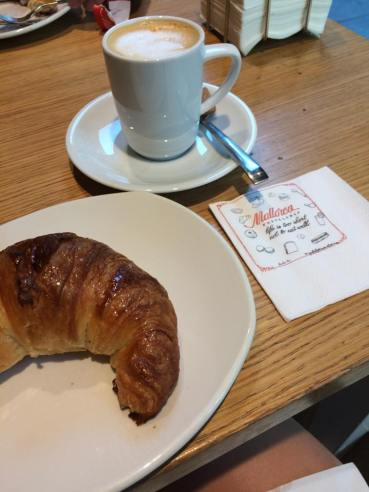 Croissant and cafe con leche in Madrid